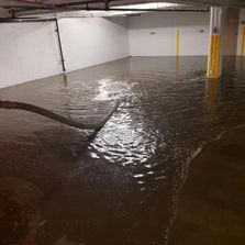 pumping out flooded basement